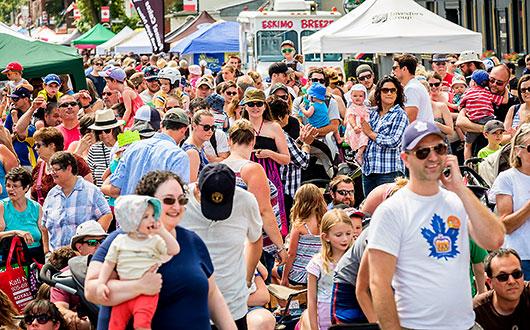 street full of festival goers