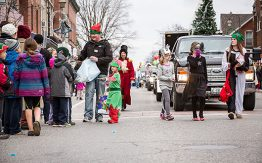 children dressed in costumes walkign the parade