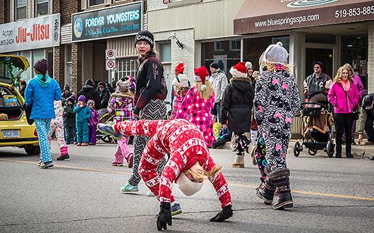 children doing backflips in the parade