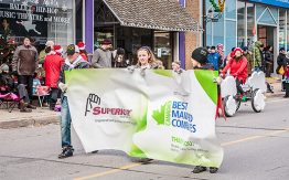 children holding Superior Glove banner in Santa Claus parade