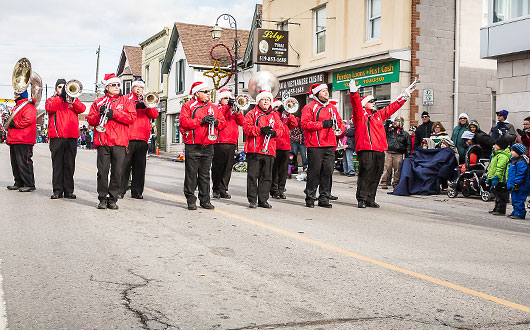 Acton Citizen's Band playing and walking in Santa Claus parade