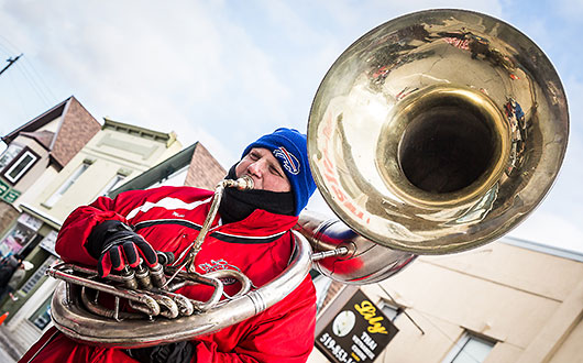 man playing bass French horn